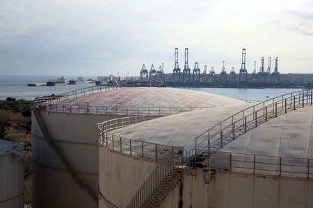freeport: gas storage tanks with Malta Freeport in the background Stock Photo