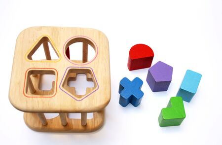 baby wooden puzzle block game isolated on a white background photo