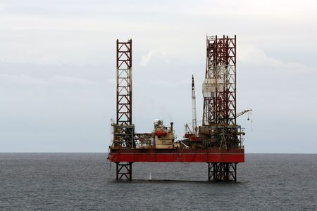 an oil rig at sea during the day photo
