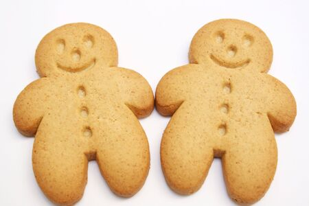 two gingerbread cookies isolated on white photo