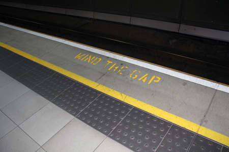 gaps: mind the gap sign at a train station