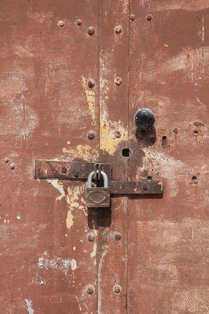 rusty metal door with padlock photo