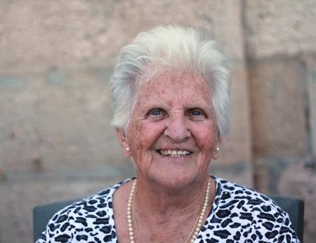 90 year old maltese lady smiling photo