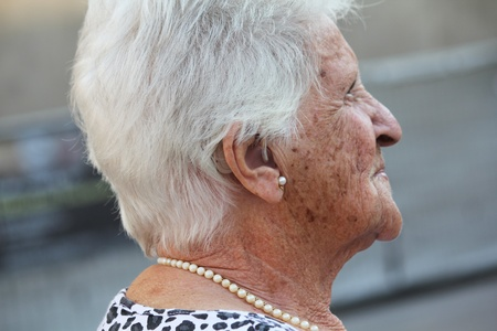 hearing aid: portrait of an old lady with a hearing aid