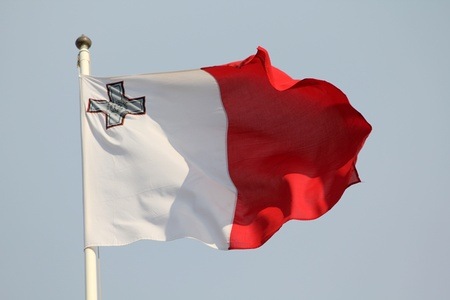 Maltese flag blowing in the wind  photo