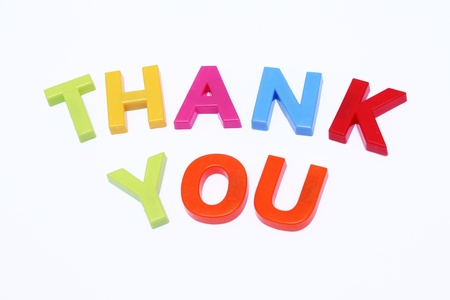 fridge magnet spelt out thank you isolated on white photo