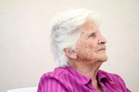 woman face profile: old Maltese lady thinking Stock Photo