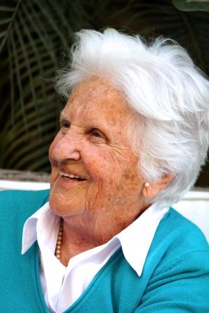 false teeth: Old happy Maltese lady smiling