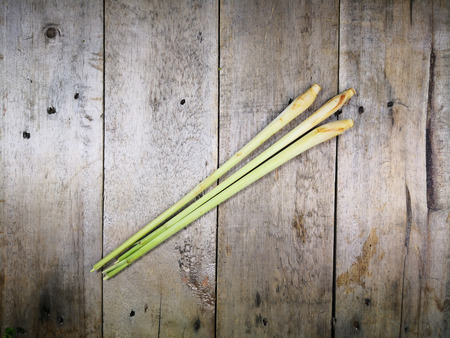 Fresh lemon grass on the wooden table, asian style. Stock Photo