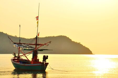 fish boat with sun rise