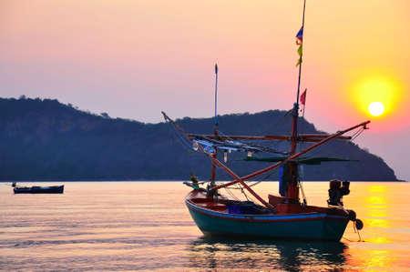 fishing boat with sunrise Stock Photo