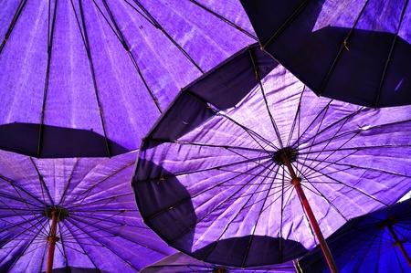 Under blue umbrella Stock Photo