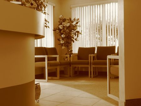 verticals: Shot of a waiting room in an office of a Doctor. Photo on sepia mode.