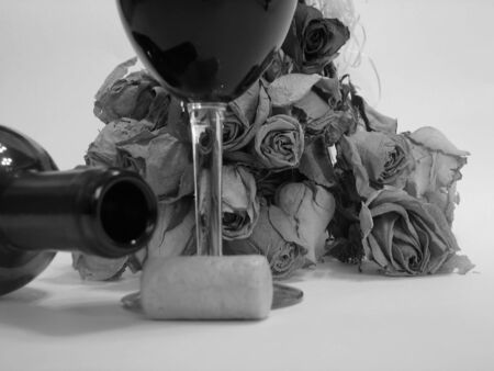 Shot of a dried roses bouquet with a bottle and glass of wine..., black and white photo, (DOF roses bouquet.) Stock Photo - 278692