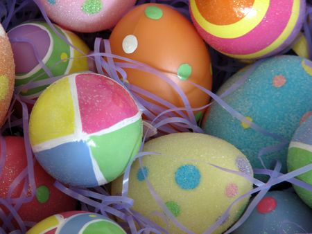 Closeup of several Easter eggs over purple artifial grass. Stock Photo