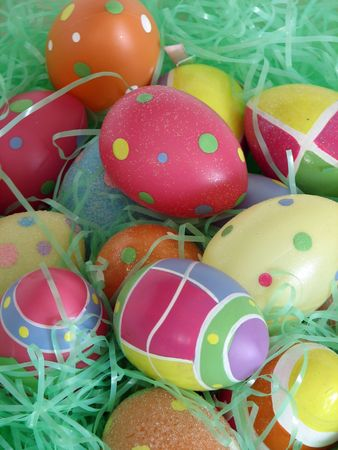 Closeup of several Easter eggs over green artifial grass. photo