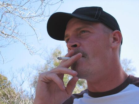 Portrait of a southern young man smoking a cigarette. photo