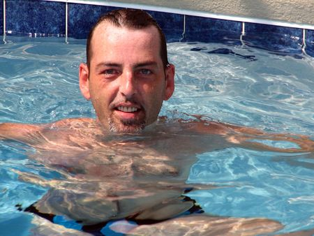 Closeup of a man floating in the pool. photo