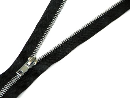unzip: Closeup of a black zipper over white.