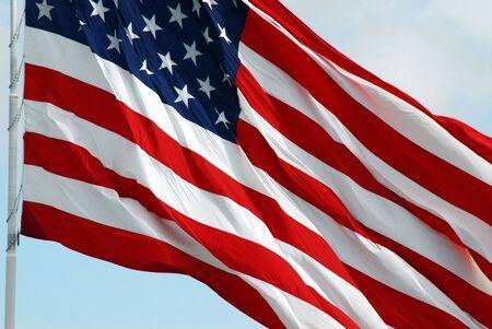 distinguishing: Macro shot of the American Flag waving.  (Motion).