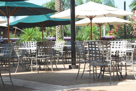 outdoor restaurant: Shot of an outdoor restaurant.  Tables and umbrellas. Stock Photo