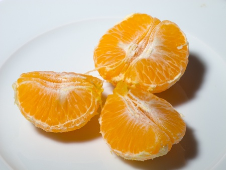 orange peel clove: peeled tangerine in white dish