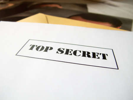 topr secret envelop on a desk above hidden pictures photo
