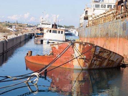 ship wreck: Sinked Ship wreck in a dock Stock Photo