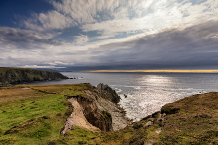 Sun and clouds at Irelands coast Stock Photo