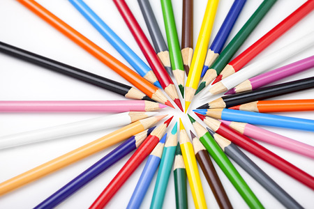 Colored pencils isolated on white background photo