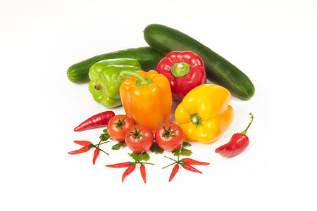 Vegetables isolated on white. Eating a diet rich in vegetables and fruits as part of an overall healthy diet may reduce risk for heart disease, including heart attack and stroke.