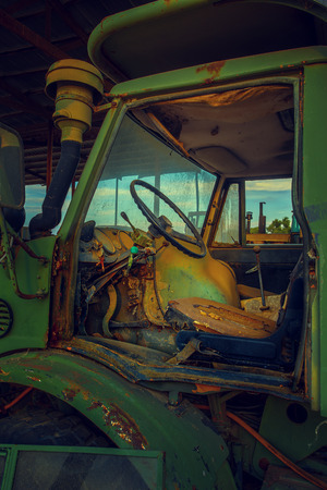 tractive: Abandoned Tractor Cab. Tractor is specifically designed to deliver a high tractive effort at slow speeds, for the purposes of hauling a trailer or machinery used in agriculture or construction.