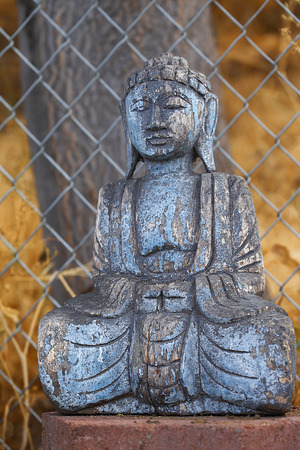 An ancient wooden Sakyamuni statue, close up, thin D.O.F. Gautama Buddha, also known as Siddhartha Gautama, Shakyamuni, or simply the Buddha, was a sage on whose teachings Buddhism was founded.