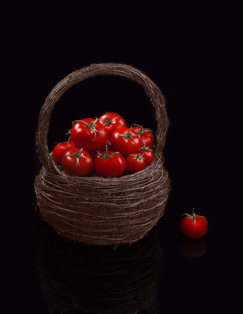 Juicy organic Cherry Tomatoes Basket. Cherry tomatoes are perfect for salads, soups, sandwiches, or just popped into your mouth for a tasty, healthy snack.