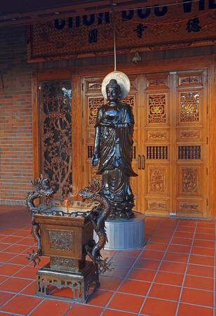 reigns: SAN JOSE, CA- USA SEPTEMBER 2014 - Chinese style Amitabha Buddha statue in Temple. Amitabha Buddha, also called Amita or Amida Buddha, reigns over Sukhavati, the western paradise, also called the Pure Land