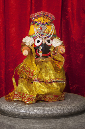 Jagannath - Lord of the universe, in Hindu Temple. Jagannath, believed to be an avatar of Lord Vishnu, is the Lord of Puri, the coastal town of Orissa in eastern India. Stock Photo