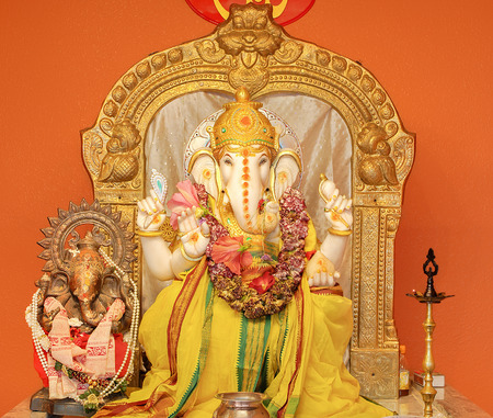 ganesh idol: Ganesha idol in Hindu temple. The Lord of Success, son of Shiva and Parvati, destroyer of evils and obstacles. He is also worshiped as the god of education knowledge wisdom and wealth. Editorial