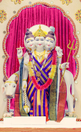 Dattatreya idol in Hindu temple. Dattatreya is considered to be an avatar of the three Hindu gods Brahma, Vishnu, and Shiva, collectively known as Trimurti. Dattatreya is  a Lord of Yoga. Spiritual seekers pray to this Supreme Teacher for knowledge of t