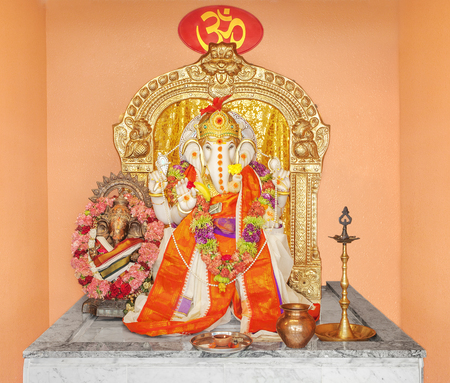 parvati: Ganesha idol in Hindu temple. The Lord of Success, son of Shiva and Parvati, destroyer of evils and obstacles. He is also worshiped as the god of education knowledge wisdom and wealth. Stock Photo