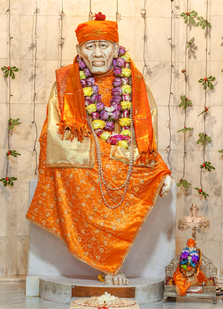 god in heaven: Sai Baba of Shirdi was an Indian spiritual master who was and is regarded by his devotees as a saint, fakir, and satguru. Stock Photo