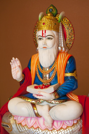 Hindu god Jhulelal. Sindhi Hindus regard him to be an incarnation of Varuna, a god of law of the underwater world. When Sindhi men venture out to sea their women pray to him for their safe return. Stock Photo