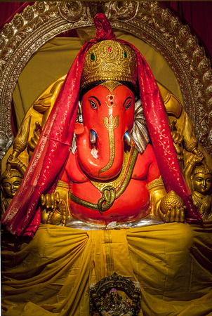 Ganesha idol in Hindu temple. The Lord of Success, son of Shiva and Parvati, destroyer of evils and obstacles. He is also worshiped as the god of education knowledge wisdom and wealth. Stock Photo