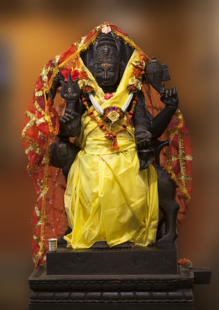 Shree Kall Bhairava. Lord Bhairav is a fierce form of Shiva. Bhairava is also called as protector, as he guards the eight directions of the universe. Stock Photo