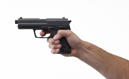 alertness: pistol in hand isolated on a white back ground Stock Photo