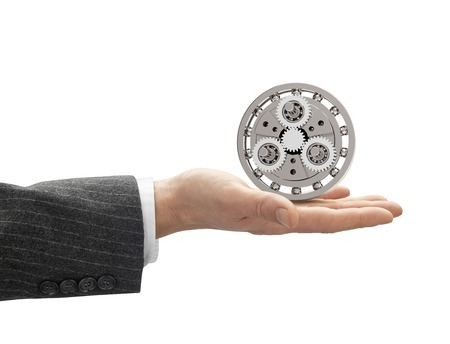 clipping: hand with metal gearbox with clipping path. Stock Photo