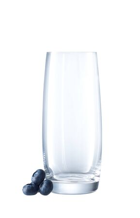 longdrink: Empty Longdrink Glass with berry isolated on white Stock Photo