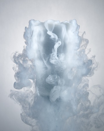 glass with dry ice isolated on a white background.