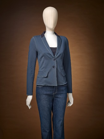 manequin: womens jacket on a mannequin isolated on a brown background. Stock Photo