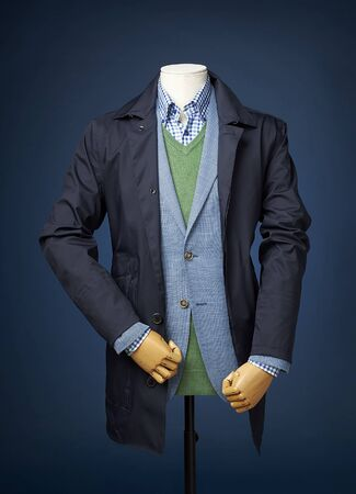 manequin: mens jacket on a manequin isolated on a blue background.