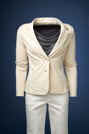 manequin: womens jacket on a manequin isolated on a blue background Stock Photo